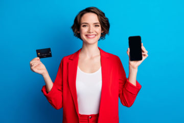 Portrait,Of,Pretty,Cheerful,Lady,Demonstrating,Device,Bank,Card,Pay