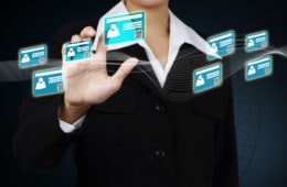Businessman,Touching,Id,Card,On,Virtual,Screen,And,Showing,The
